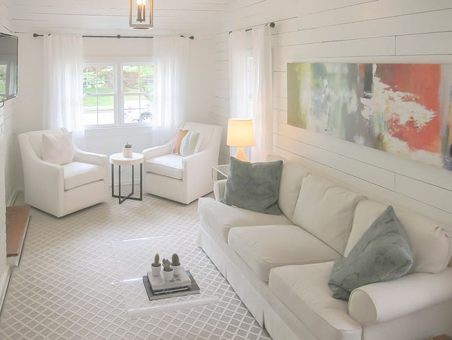 The sunroom/den is steps away form the kitchen in a space that was formerly a garage.