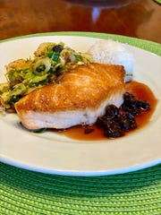 Pan Seared Salmon with a Dried Cherry Gastrique from Tsunami Restaurant.