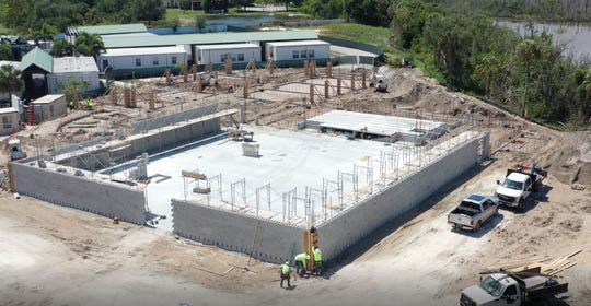 Construction workers build Marco Island Academy's new facilities May 7, 2020.