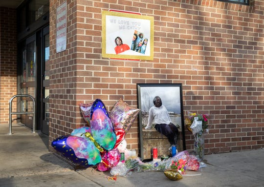 A memorial is set up outside the Walgreens store for worker Cathy King, who was shot and killed Tuesday outside the store. The suspect in the homicide had been in a relationship with King, police said.