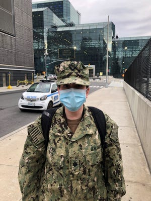 Tabitha Eden poses in front of the Javits Center in New York City in April where she worked as a nurse educator and on the rapid response team for the coronavirus.