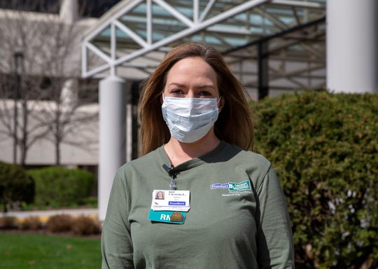 Christin Lissmann, an ICU nurse at Froedtert & the Medical College of Wisconsin, poses for a portrait in front of the hospital on Thursday, May 7, 2020. Lissmann provided needed care to Municipal Court Judge Derek Mosley, who contracted COVID-19 in late March.