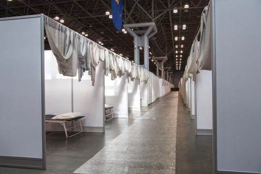 Makeshift hospital rooms stretch out along the floor at the Jacob Javits Convention Center in New York.