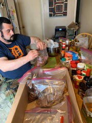 Nate Denofre prepares food to dehydrate for the trip last month.
