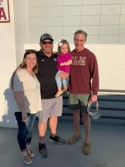(Left to right) Anna, Ryan and Adaline Gregory reunited with Dr. Steve Flynn prior to ULM's baseball game against Ole Miss on March 10.