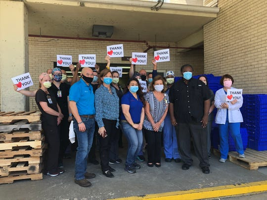 St. Francis workers accept 1,000 meals purchased through a donation from Cai Wei, Consulate General of China in Houston. The meals were prepared by Texas Roadhouse and are enough to feed all workers at the hospital.