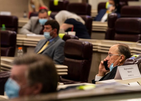 Rep. Reed Ingram takes a phone call at the Alabama State House in Montgomery, Ala., on Thursday, May 7, 2020.