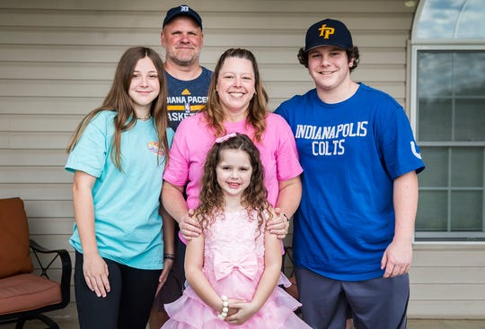 COVID-19 survivor Valerie Morris with her family at their home in Yorktown Thursday, May 7, 2020.
