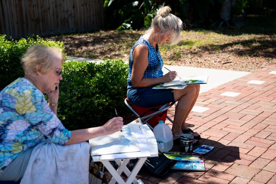 Denni Glick, left, and Cheryl Leach, right, paint scenes of the farmers market off of Old 41 Road in Bonita Springs on Wednesday, May 6, 2020.