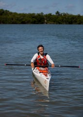 Mark Cecil poses for a portrait in his kayak in Estero Bay on Wednesday, May 6, 2020.