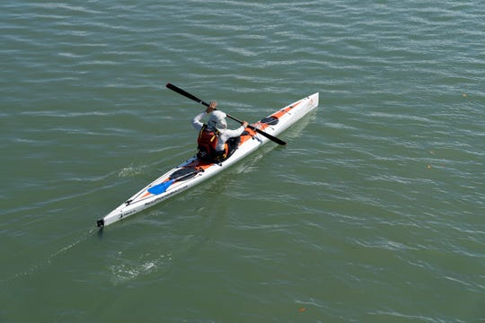 Mark Cecil kayaks in Estero Bay on his 62nd birthday on Wednesday, May 6, 2020. Cecil recently participated in the Ultimate Florida Challenge, kayaking 1,200 miles around the Florida peninsula. Wednesday was Cecil's first time back in his kayak after completing his journey, which he started on March 7.