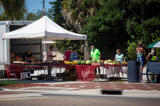 Customers shop at the farmers market off of Old 41 Road in Bonita Springs on Wednesday, May 6, 2020.