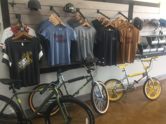 Some of the apparel and bikes offered by Rusty Spokes in Pataskala.