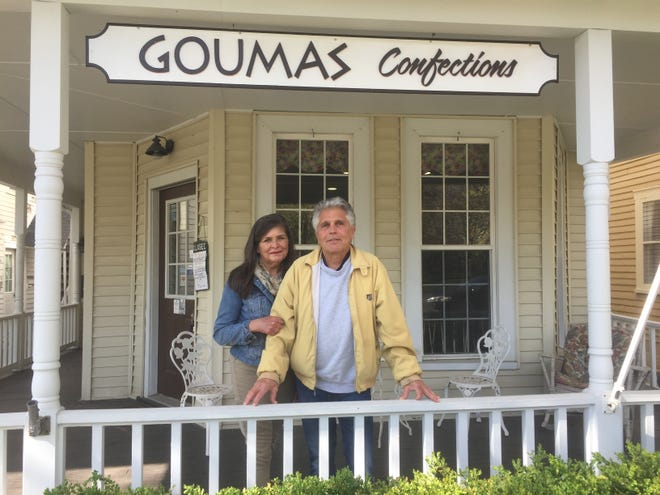 """Krisanne and Socrates """"Soc"""" Goumas, on the front porch of their Granville location fronting Broadway. Mother's Day will mark the last holiday for the longtime candy-maker."""