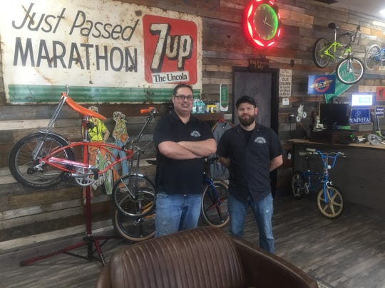 """Nick Matheny and Kevin Hunziker recently launched a soft-opening for """"Rusty Spokes Bicycle Co."""" in Pataskala."""