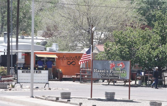 Hazels's Flowers and Infinite BBQ are pictured, Thursday, May 7, 2020, in Farmington.