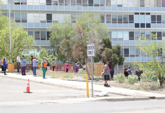 People gather outside Gallup Indian Medical Center on May 7 to watch aircraft from the Arizona Air National Guard to flyover the hospital in Gallup. The guard was showing appreciation to health care workers treating patients with COVID-19.