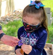 Three-year-old Adelina prepared her butterfly to be  placed on the Peace Tree in loving memory of her grandmother.
