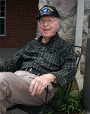 WWII veteran Robert Tessmer, 94, outside his New Hudson residence on May 7, 2020.