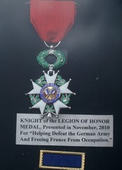 """Already a Bronze Star recipient for """"individual heroism in combat"""" Robert Tessmer is mostly proud of this the Knight of the Legion of Honor Medal he received from the French government for helping to defeat the German army."""