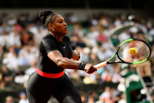 Serena Williams plays a return during a match in 2018.