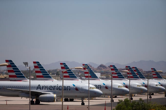 Jets sit parked near the run way at Phoenix Sky Harbor International Airport on May 7, 2020.