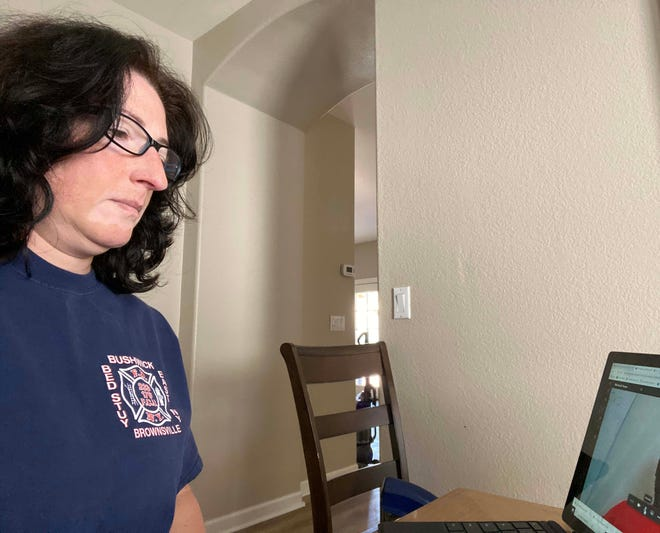 Janine Menard, a counselor at Sheely Farms Elementary School in Tolleson, meets virtually with a co-worker on May 1.