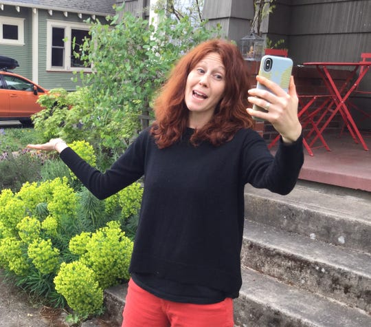 Megan Bledsoe, a counselor at Discovery Middle School in Vancouver, Washington, records a video for students about how to stay physically active from her home in Portland, Oregon.