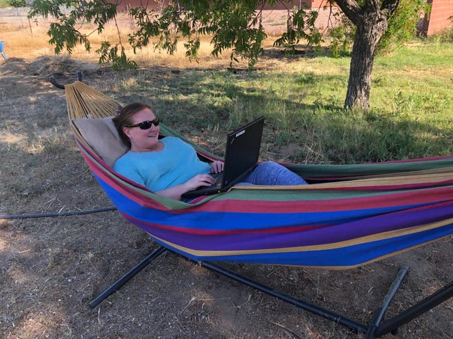 Shiloh Wheeler, a counselor with the Thatcher Unified School District in rural Arizona, works outside her home on April 27. Until this school year, Wheeler was the only counselor for all 1,750 students in her district.