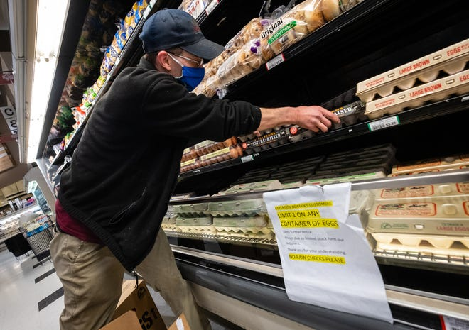 Neiman's Frozen Dairy Manager James Ziegenbein stocks eggs Thursday, May 7, 2020, in the St. Clair store. Essential workers have until midnight on New Year's Eve to apply for the Futures for Frontliners program, which provides free college tuition to workers without a college degree.