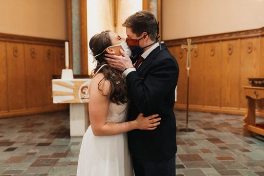 Despite the challenges of having their wedding plans changed by the coronavirus pandemic, Maddy Moldenhauer and Devin Haberling were still married at Immanuel Lutheran Church in Grand Rapids on April 25, 2020.