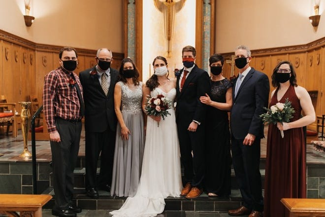 Despite the challenges of having their wedding plans changed by the coronavirus pandemic, Maddy Moldenhauer and Devin Haberling were still married with limited family at Immanuel Lutheran Church in Grand Rapids on April 25, 2020.