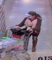A masked suspect, later determined to be Annette Ramsey, charged in connection with retail theft at the Grocery Bargain Outlet Market.