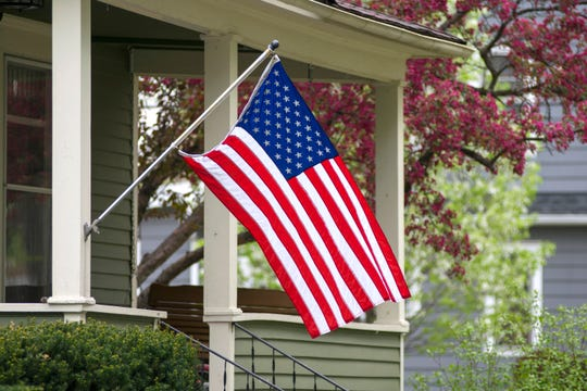 An American household has decided to mount their nation's flag outside.