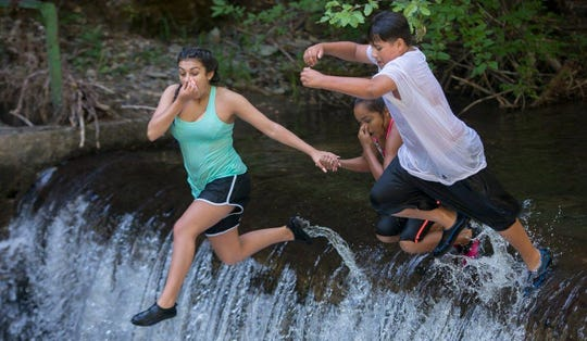 Kids take the plunge at Camp Hope near Yreka. Organizers plan to open for some camp activities in August.