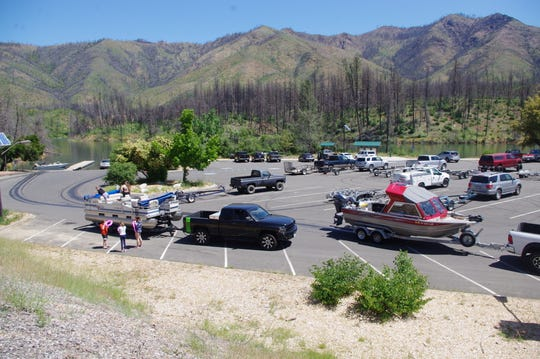 A parking lot at Whiskeytown National Recreation Area was bustling on Wednesday, despite the statewide stay-at-home order.