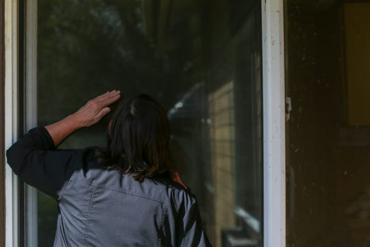 Danna Fleener, 59, presses her face against the window to see her mother, Mary Davis, 81, who is recovering from COVID-19 in isolation at the The Oaks at Sherwood Park in Keizer on May 6, 2020.
