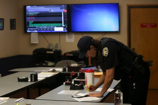 Officer Michelle Pratt gets ready for her day-shift patrol in the briefing room at the Salem Police Department on May 6, 2020.