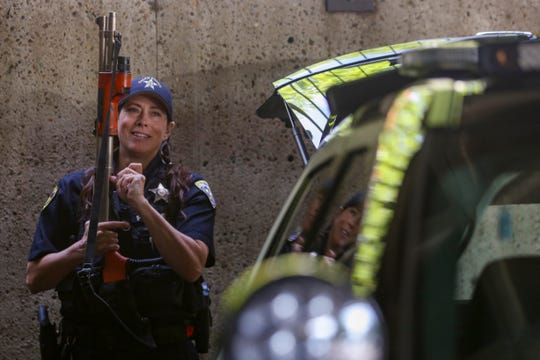 Officer Pratt loads a less lethal beanbag shotgun before going out on patrol at the Salem Police Department on May 6, 2020. She has never used it on-duty.