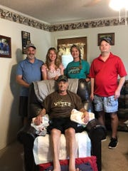 U.S. Navy veteran Albert Janca, seated, with his children, standing from left, Allen Janca, Kristi Lewis, Angie King and Kevin Janca.