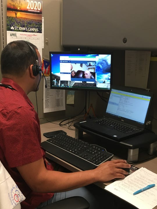 Dr. Jose Ayala-Torres, Primary Care Physician with West Texas VA Health Care System, conducts a virtual health care appointment with U.S. Navy veteran Albert Janca and his daughter Kristy Lewis, using VA Video Connect.