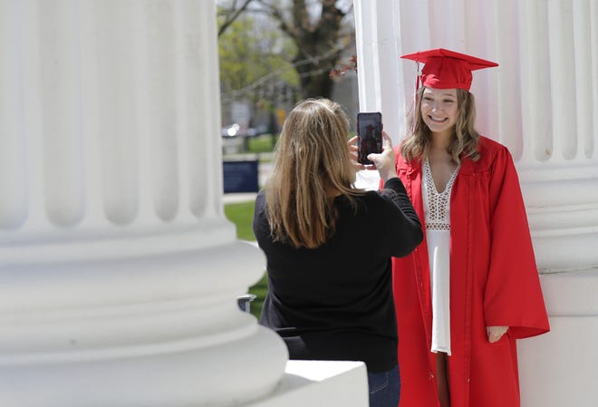 Kimberly High School senior Kaileigh Smith has her photograph taken by her mother Jodie Smith for her upcoming virtual high school graduation Thursday, May 7, 2020, in Appleton, Wis.  Dan Powers/USA TODAY NETWORK-Wisconsin
