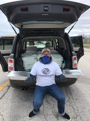 Andrew Jakus, unit director of Club at the Y, the Boys & Girls Club location at the Sheboygan YMCA on Broughton Street, delivers meals to club families.