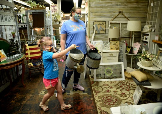 Cheryl Thompson and Amelia Thompson go shopping at the Antiques Shoppes At 1100 Barksdale.