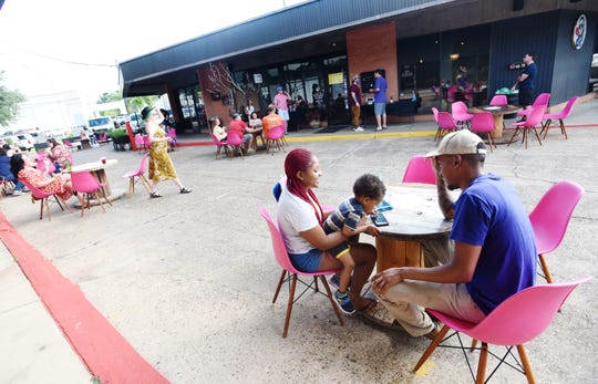 People practice social distancing at Ki' Mexico where people can eat outside.