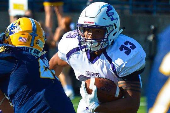 Gabe Watson carries the ball in a win over Augustana in 2018.
