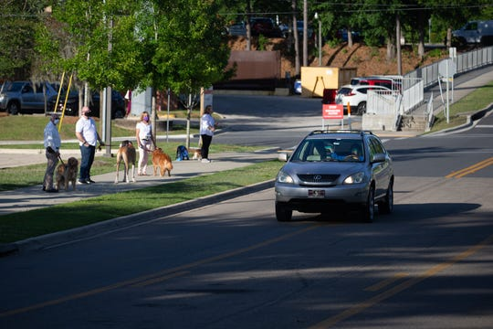 Roughly 40 Tallahassee Memorial HealthCare Animal Therapy teams lined Surgeons Drive to thank TMH workers for their service during the COVID-19 pandemic at shift change Wednesday, May 6, 2020.