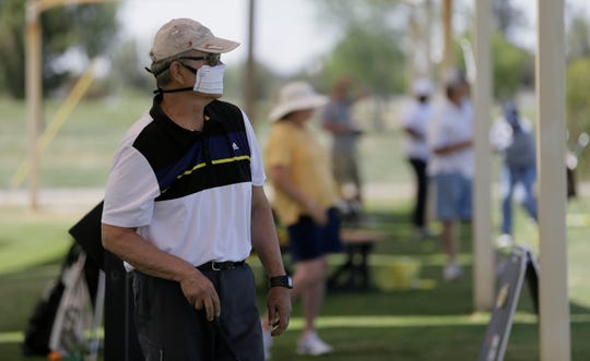 Celso Trujillo warms up at the driving range at Ascarate Golf Course Thursday before hitting the course. Courses are operating with additional restrictions across El Paso.