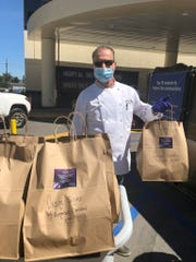 Tommaso Barletta, chef and owner of Tuscany Il Ristorante in Westlake Village, suits up to deliver meals to hospital workers.