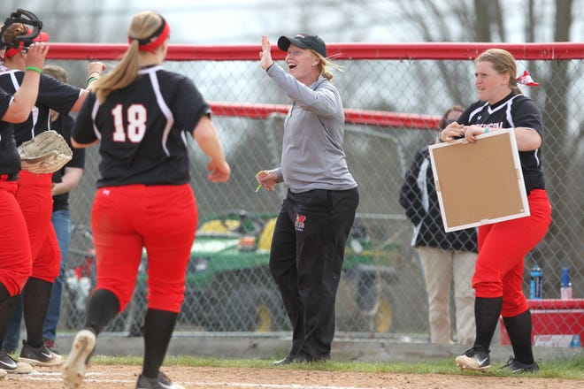 Muskingum head softball coach Kari Winters meets her team coming off the field during a game. Winters and her Muskingum colleagues are now relying on technology to stay in contact with potential recruits during the pandemic.